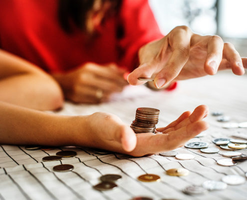 Adult Placing Money in Childs Hand
